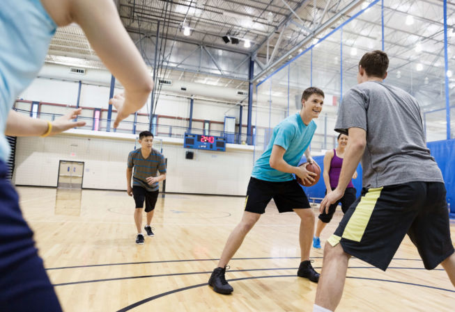 several students play intramural basketball
