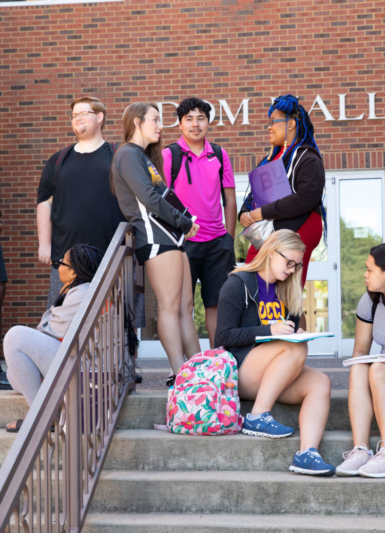students gather outside of class