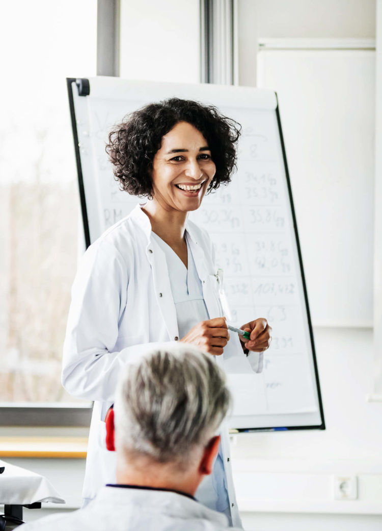 a healthcare administrator presents during a meeting
