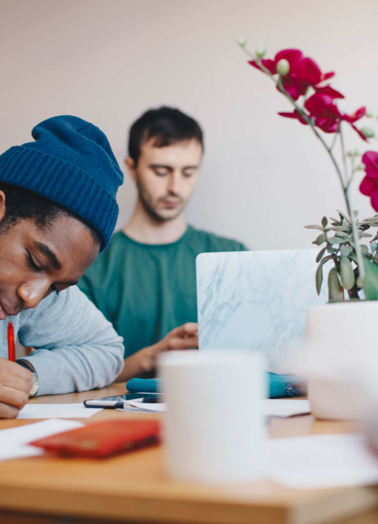 a student works on homework with a tutor