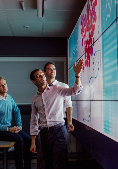 a group of business people discuss a chart during a presentation
