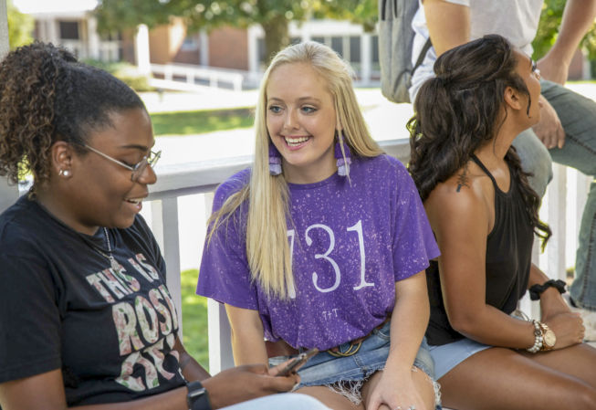 two female students talk about life on campus