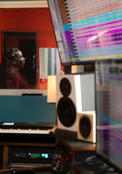 A woman singing in a recording studio